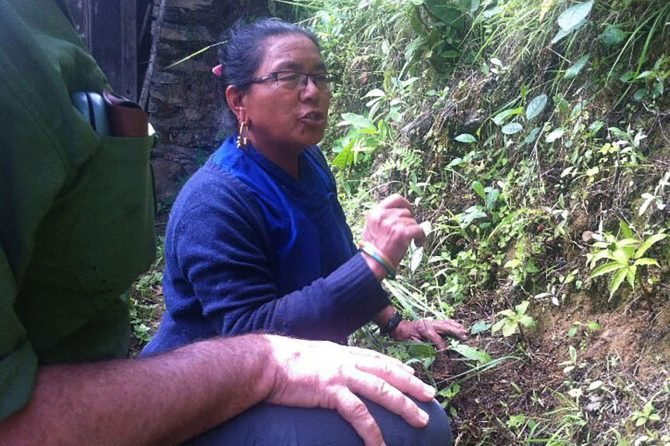 A woman in a high-hill village explaining the diversity of medicinal plants